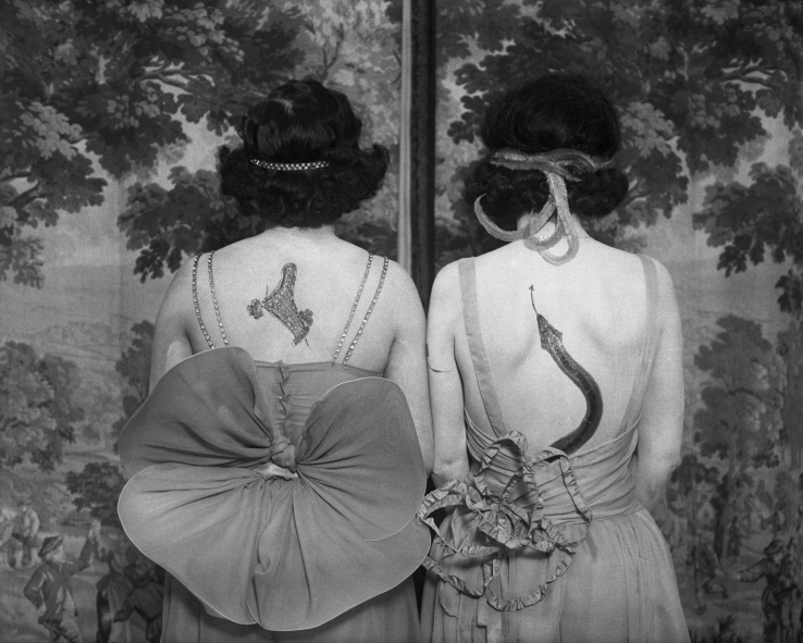 Women wearing tattoos and costumes